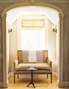 Love the linen Roman shade and a settee in the nook.  Via Country Living
