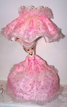 I had this lamp.  Only mine had the white dress with the same flower print as this one and she had brown hair.  Bradley dolls were strangly popuar.