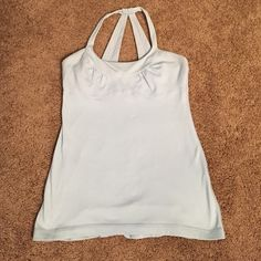 Lululemon workout tank Baby blue lululemon scoop neck tank top with built in bra -no padding. Still has lots of life left and ready for new owner. lululemon athletica Tops Tank Tops