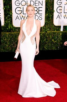 Kate Hudson wearing a white cut-out Versace gown and Jimmy Choo clutch at the 72nd Annual Golden Globes