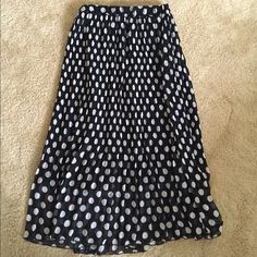 Polka dotted Maxi Skirt Pre-owned Polka-dotted maxi skirt. Pleated. One size. Garterized waist. Poly fabric so it's machine washable! Great condition! Skirts Maxi