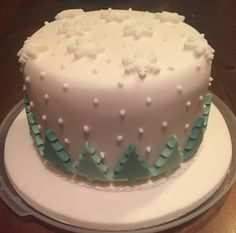 Christmas Cake with trees and snowflakes and royal icing snow. Simple but effective