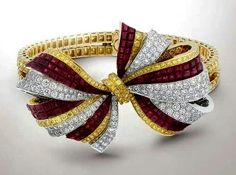 Van Cleef & Arpels White And Yellow Diamond Bow Bracelet With Rubies.......