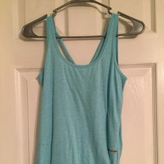 VS Sport Side Tie Tank Worn once. Light blue color. Sport line of VS. Ties on left side. Scoopneck front and back with straps also crossing over on back. Thin material. Victoria's Secret Tops