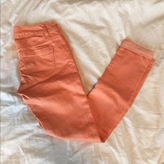 American rag coral jeans Super cute coral skinny jeans. Only worn twice. Size 1 regular American Rag Jeans Skinny