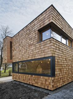 Wooden shingles give a rough texture to the walls of this extension to a youth centre by Bernd Zimmermann