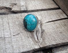 A unique and edgy tibet turquoise cabochon has been set in sterling silver. This tibet turquoise stone has a wonderful black accent detail making this turquoise ring stand out giving it a little bit o
