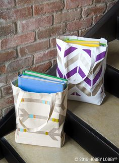 Printed totes like these make DIY style look effortless. To snag this look, follow these simple, step-by-step instructions! Arrow Design: 1) Trace design onto a stencil blank and cut it out. 2) Place on bag and paint in desired colors.   Herringbone Design: 1) Tape off design using a combo of wide and narrow tape strips. 2) Paint the bag in desired colors.