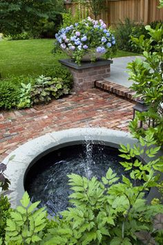 Urban Retreat- Fountain and large planter with hydrangea.