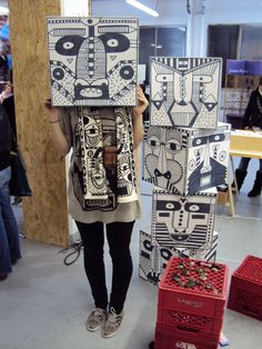 patterned boxes which look like African masks or totem poles