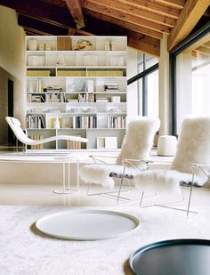 Residence Of Mariateresa Facchini-- white contemporary furniture and exposed wooden beams