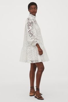Short dress in an airy cotton weave with broderie anglaise. High stand-up collar, an opening with a button at the back of the neck and wide, long sleeves wi Cotton Wedding Dresses, White Lace Wedding Dress, White Dress, Casual Summer Dresses, Nice Dresses, Short Dresses, Eyelet Dress, Lace Skirt, Broderie Anglaise Fabric