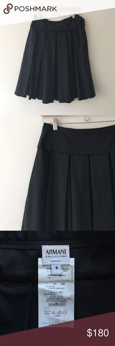 ARMANI Collezioni Wool Pleated Skirt Stunning Virgin wool pleated skirt in charcoal gray/black By ARMANI Collezioni. Made in Italy. 97% virgin wool 3% elastane. Side zip with faux dash tie. Fully lined. Size 6. Impeccable condition! Armani Collezioni Skirts A-Line or Full