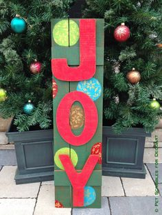 Wooden Outdoor JOY Sign -- Make an outdoor JOY sign in a vintage style that matches your existing Christmas decorations! This tutorial shows you how with step by step photos and instructions.