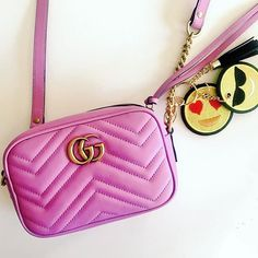 Gucci bag and emoji bag charms