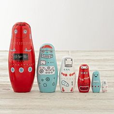 Shop Robot Nesting Dolls.  In the future, robots will have hand painted wooden bodies with cheerful expressions and retro patterns designed by artist Dinara Mirtalipova.  But in the present, these robot nesting dolls already have all those things.