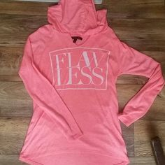 Flawless shirt Long sleeve with hood tag says small but it runs a little big. Unless you are going to wear it like a tunic. High in front low in back. Very small hole under armpit. Wouldn't be noticeable when on. So soft and comfy jcpenney Tops Tees - Long Sleeve
