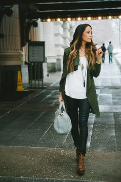Dark wash skinnies + flowy white top + wedges + army green jacket + accessories. This would look great with a fedora or floppy hat