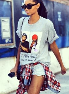 la modella mafia Chanel Iman model off duty street style in a hip hop tee, cut off shorts, plaid shirt tied around the waist and thigh high ...