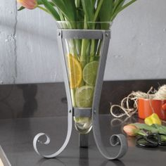 "Mineral Metalworks Vase and Stand A simple and easy way to give more pizzazz to your floral arrangements. Glass insert gives room for you to be imaginative with what you place at the bottom. 9""w x 111⁄2""h ON SALE Was $29.99 Now $8.99 Supplies Limited. See More @ https://athomewithkevin.athome.com/summer-sale-floral/mineral-metalworks-vase-and-stand.html"