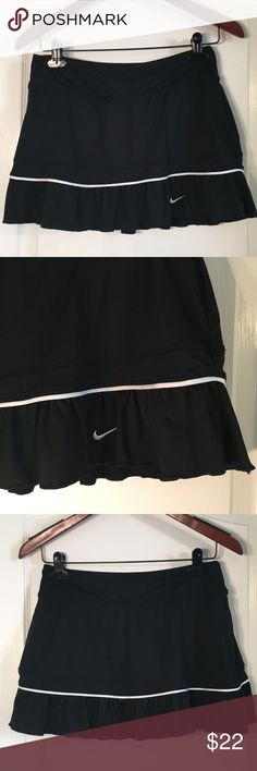 "Nike Dri Fit Black With White Trim Athletic Skirt Nike Dri Fit Black With White Trim Athletic Skirt With Shorts ~ Size Medium ~ Waist is approximately 14 1/2"" (Stretchy) ~ Length is approximately 12"" ~ 87% Polyester & 13% Spandex Nike Skirts"