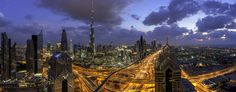 Heart of Dubai - It was a perfect day for skyline photography today, i decided to shoot a very large panorama to show the entire view.  Was very challenging to capture the clouds that constantly moving during to the high wind & mainly since i wanted to shoot several vertical shots (around 8 shots) to transform at the end as a huge pano image with almost 2.5GB. Shot with Carl Zeiss 28mm at maximum resolution on D800 body.