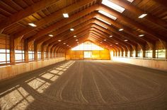 I gotta have an indoor riding arena :) Love the windows on the sides and the lights above!