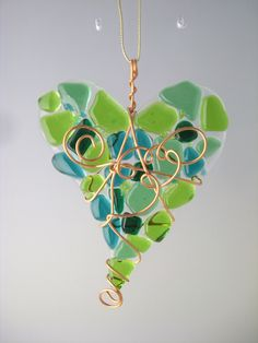 Fused glass heart suncatcher in shades of green. Item H5GR. $14.50, via Etsy.