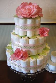 Super cute diaper cake, maybe use yellow or orange neutral colors instead