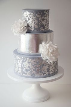 Wildflower Cakes London Wedding cake with sugar roses and distressed silver leaf #weddingcakessilver