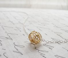 tangle ball necklace...because sometimes life is a tangled mess, but it's still a beautiful, tangled mess..and it's mine.  :)