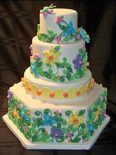 This cake is a cake that I dream of someday making. Need to perfect my decorating and quilling to do it. Courtesy of The Grand Finale.