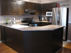 Rust Oleum Countertop Transformations allows you to paint your countertops so they look like granite.