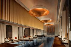 Aman New York Spa Image Open to guests, residents and Aman Club members, a square metre Aman Spa fills three storeys, with a dramatic 25 metre indoor swimming pool surrounded by fire pits and daybeds as its centrepiece. Four Seasons Hotel, Central Park, Bangkok, Destinations, London Property, Hotel Branding, New York, Das Hotel, Thing 1