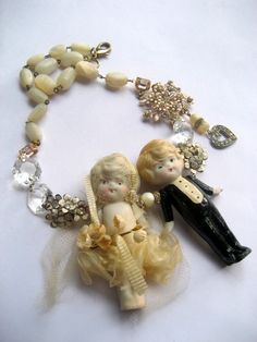 This is very similar to the antique cake topper for Leslie and Mike's wedding cake. Cameo Jewelry, Metal Jewelry, Jewelry Art, Vintage Jewelry, Jewlery, Frozen Dolls, Mod Podge Crafts, Recycled Jewelry, Kewpie