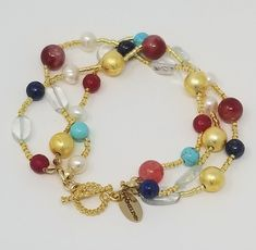 LUSCIOUS SPARKLING GOLD BEIGE PEACOCK BEADS bracelet