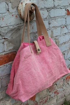 Perfect canvas bag for a weekend getaway! The tote is made from Coral cotton with leather handles and closures. Leather snap closures allow the bag to expand, as shown. Steal away in style to a lakesi Weekender Tote, Tote Bag, Carpet Bag, Boho Bags, Craft Bags, Linen Bag, Cloth Bags, Beautiful Bags, Leather Bag