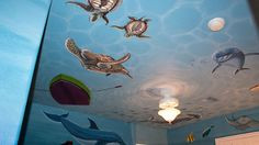 Under the ocean murals on the ceiling too!