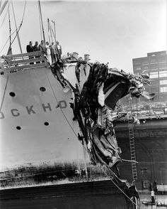 Members of the U.S. House of Representatives Subcommittee look down on the damaged bow of the ocean liner Stockholm at the Brooklyn, N.Y., shipyard where the Swedish-American liner is undergoing repairs, Aug. 1, 1956.