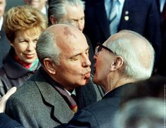 Soviet Leader Mikhail Gorbachev and his wife, Raisa, are welcomed by East German Leader Erich Honecker (R) with a fraternal kiss in East Berlin after the Gorbachevs arrive to celebrate the anniversary of East Berlin, Marie Curie, Ronald Reagan, Vladimir Putin, Steve Jobs, Joe Biden, Fall Of Berlin Wall, Einstein, Donald Trump, Mikhail Gorbachev