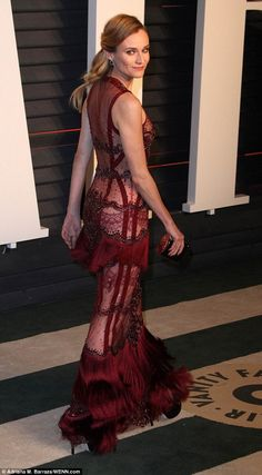 Leaving left little to the imagination: The 39-year-old opted to forgo underwear as she slipped into a sheer gown