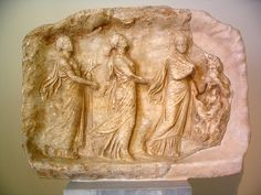Votive relief in the shape of a cave, showing the three Hours and Pan. Pentelic marble. From Sparta or Megalopolis. 330-320 BCE  Athens National Museum