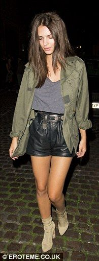 Strutting her stuff: The stunning model wore a green military-style jacket open over a gre...