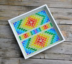 Handy serving tray made of white wood, and covered with bright glass mosaic glitter tiles in a rainbow pattern. Grouted in white and sealed. The wooden