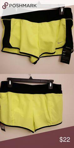 Nike dri-fit running shorts Nike yellow and black trim running shorts Nike Shorts
