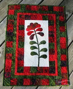 I found this amazing quilt at the Accuquilt Quilters Spotlight. See Show-and-Tell from other quilters or share your favorite. Batik Quilts, Lap Quilts, Small Quilts, Mini Quilts, Applique Quilts, Floral Quilts, Hanging Flower Wall, Quilting Projects, Quilting Ideas