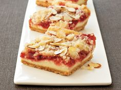 Cherry Cheesecake Bars (sugar cookie mix, butter, cream cheese, cherry pie filling, sliced almonds - easy!)