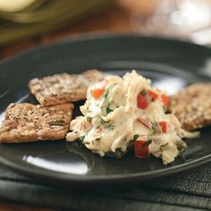 """Slow-Cooked Crab Dip Recipe- Recipes """"This is great for entertaining because it frees up the oven."""" Crab lovers will adore it. Serve leftovers on a baked potato. Slow Cooker Dips, Crock Pot Slow Cooker, Crock Pot Cooking, Slow Cooker Recipes, Crockpot Recipes, Cooking Recipes, Cooking Tips, Appetizer Dips, Yummy Appetizers"""