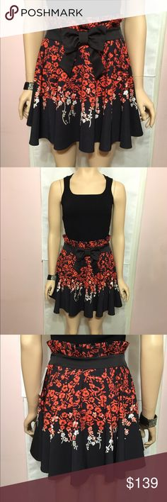 NWT Stunning Floral Skirt with Bow Flowy skirt in gorgeous colors black, orange, white with a black bow at center, pleated at waist, hidden zipper at side, European size 38.  Fabric is superb in this skirt by Calore. Tags and price are on Skirt. Skirts
