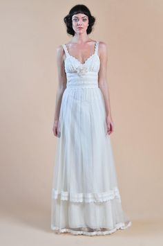 Uh oh - it's happened - I've found a dress designer I can't afford... You don't reeeeally need food at a wedding, right!?